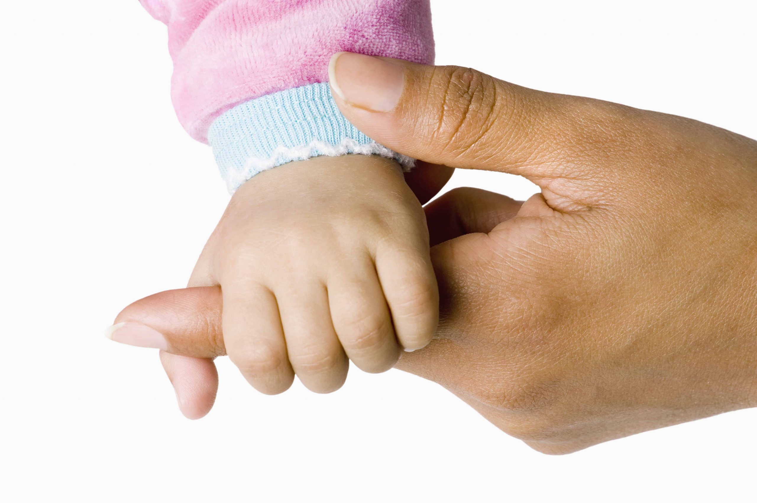 Mother holding her healthy daughter's hand after a positive and calmer birth