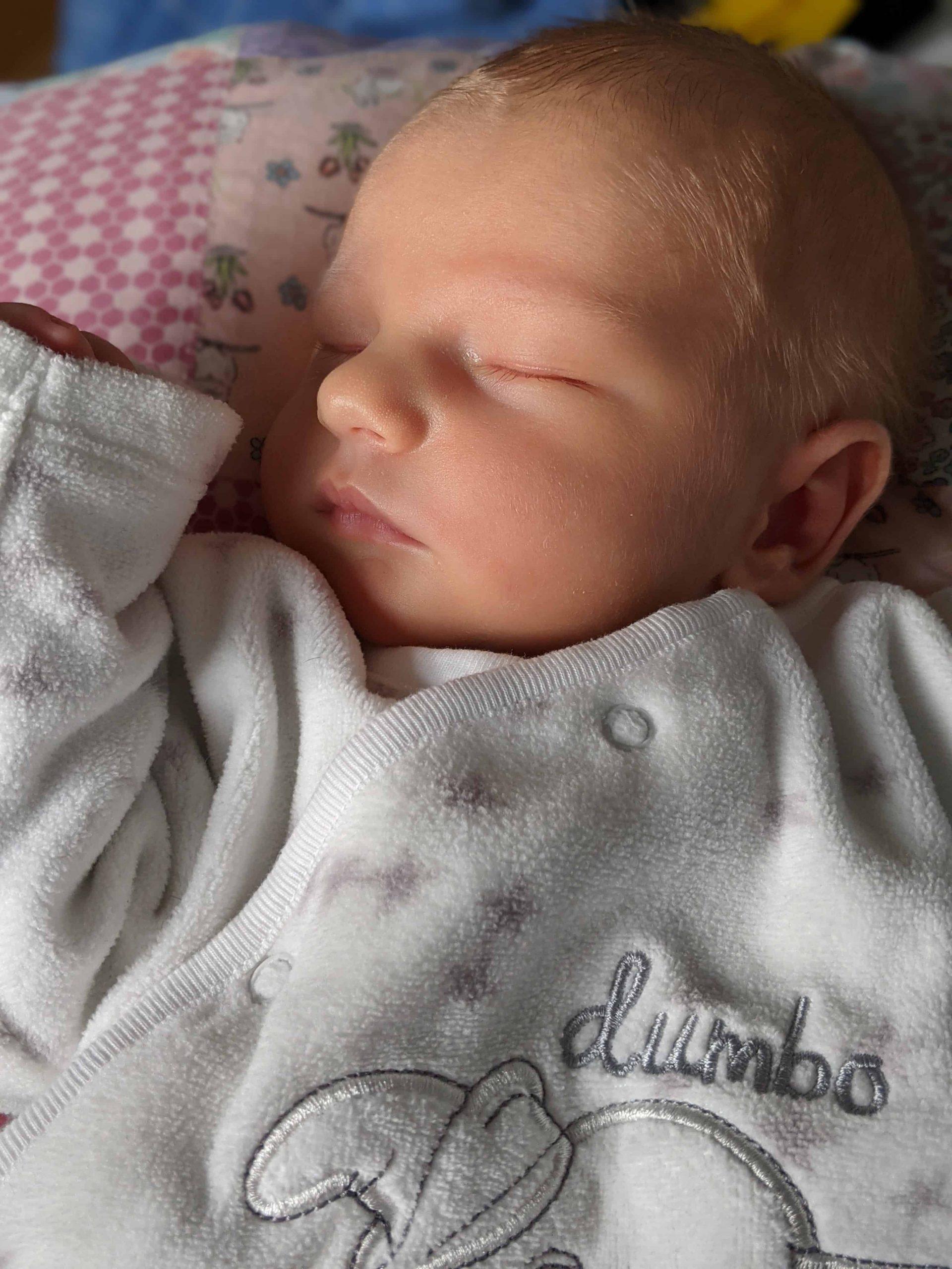 a calm sleeping cesarean section baby